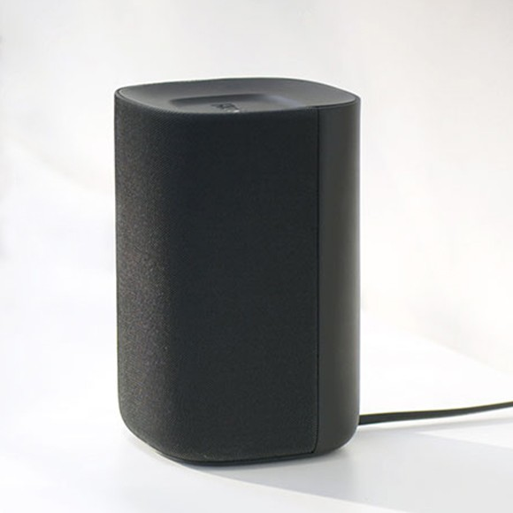 A single Roku TV Wireless Speaker showing its power cable plugged in