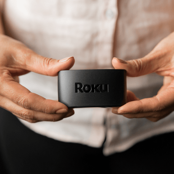 Person holding a Roku Express