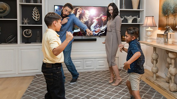 Image of people dancing to music after they buy Roku Smart Soundbar