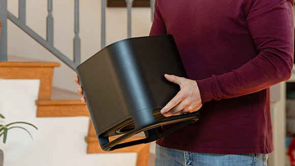 Person carrying the Roku Wireless Subwoofer